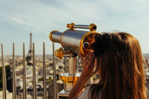 telescope pointing to Eiffel Tower and Paris streets