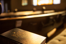 A Bible and church pews.