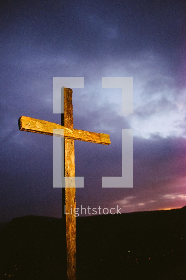 Wooden cross at sunrise.