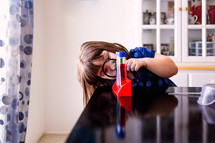 a girl doing a chemistry experiment