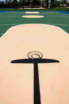 shadows on a basketball court outdoors