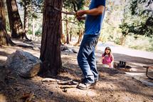 a man gathering sticks for a fire
