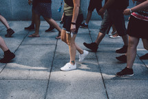 crowds of people on a sidewalk