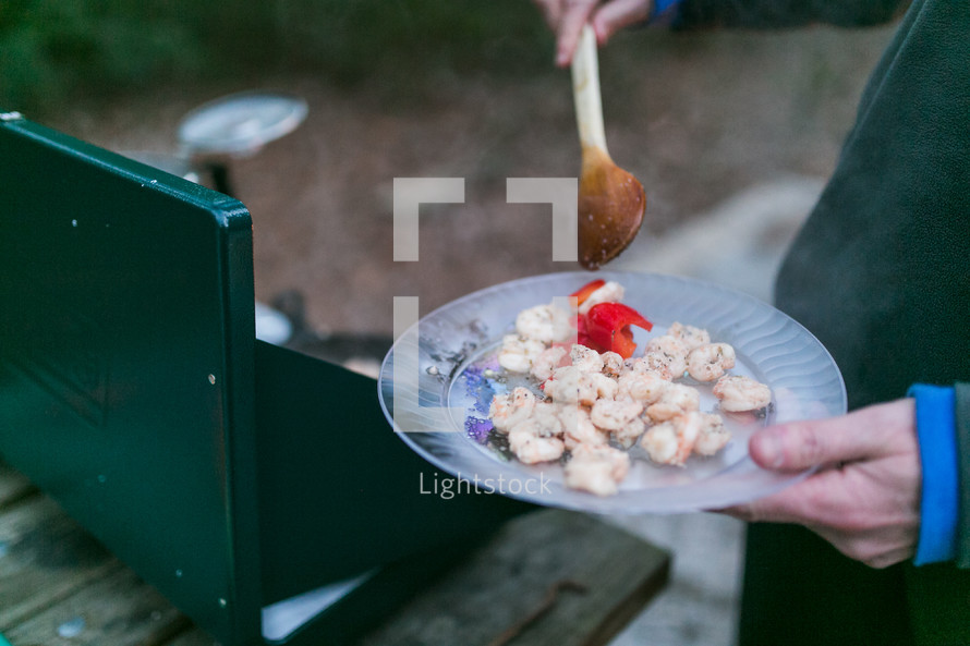 cooking seafood on a camping stove