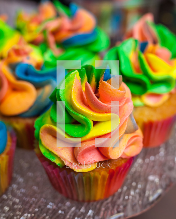 colorful icing on cupcakes