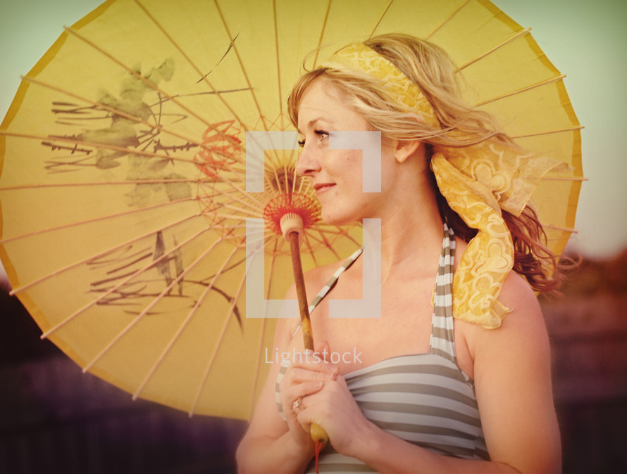 A woman with a parasol.