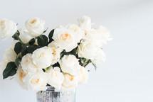roses in a metallic tin vase