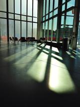 sunlight shining through windows into a lobby