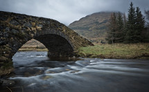 water flowing under Buttler bridge in Scotland
