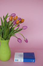 Bible and tulips in a vase