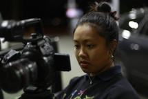 A young woman working with a view camera.
