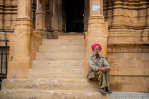 a man sitting on steps in India