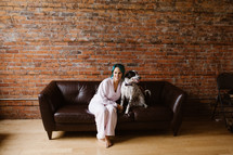 women with her dog on a couch