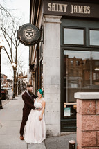 bride and groom on a downtown sidewalk