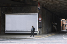 Businessman looking at a blank billboard