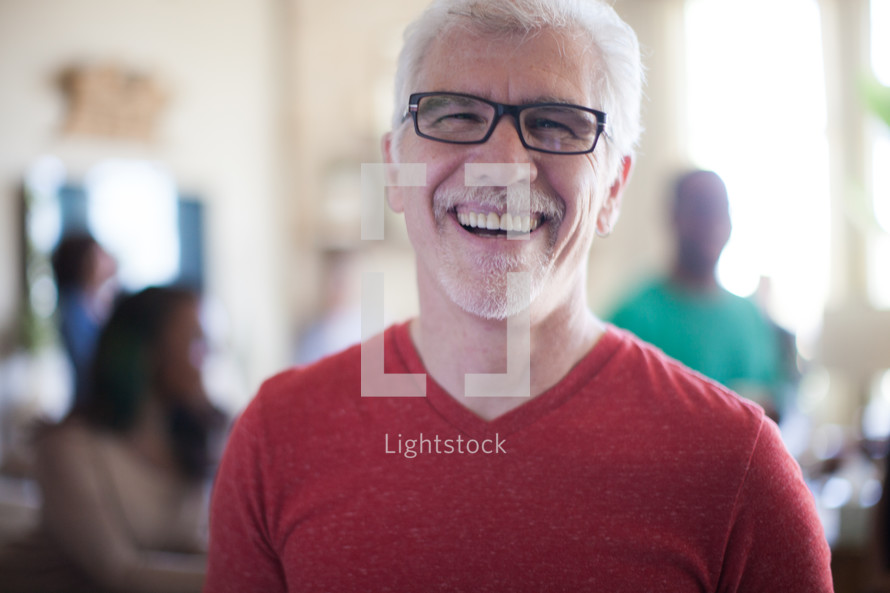 man smiling at a small group meeting