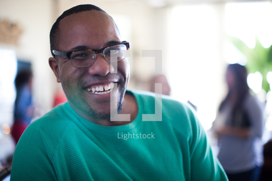 A smiling young man in glasses.