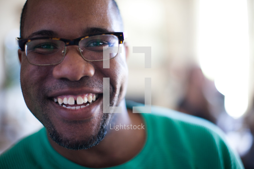 face of a smiling man at a small group gathering