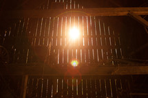 sunlight through slates in a barn