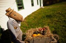 outdoor fall display with a wheelbarrow