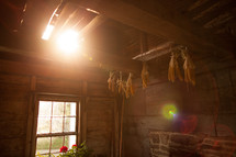sunlight through a window into an old farm house