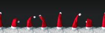santa hats in snow