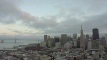 Downtown San Francisco | Aerial | Neighborhood | Community | People | Urban | Evangelism | World | Buildings | Skyscrapers | Bay Bridge | Bay Area | Clouds | Evening