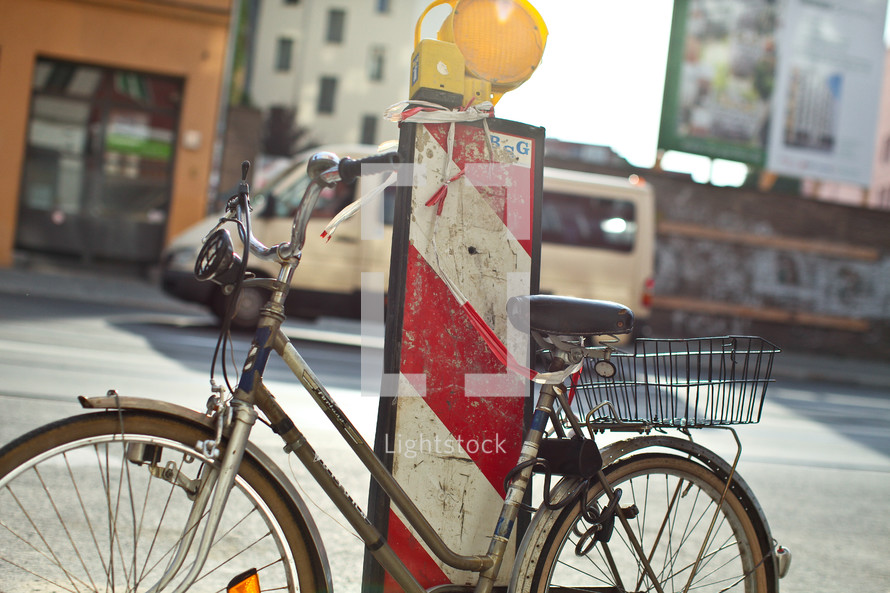 A bicycle rests next to a roadwork pylon in Berlin
