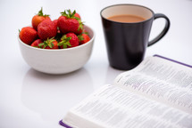 strawberries, coffee mug, and open Bible