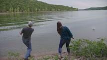 couple skipping rocks