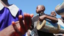 children singing and playing drums in Kenya