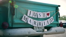 Just married on the back of an old truck
