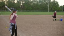 woman hitting a softball