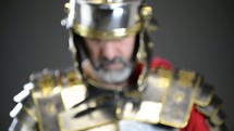 Roman soldier holding a crown of thorns