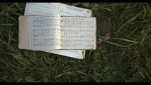 hymnal in the grass
