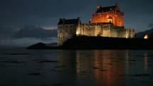 a castle in the rain at night in Scotland