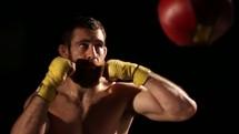 man punching a punching bag