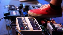 feet on guitar pedals