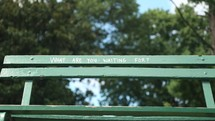 what are you waiting for written on a park bench