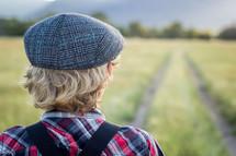 a boy standing in a field