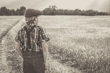 a young man looking into a field