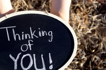 Thinking of You Written on Chalkboard