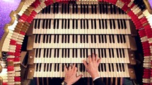 hands playing an organ