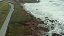 aerial view over a shoreline and lighthouse