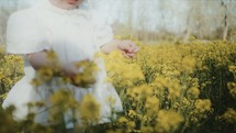 toddler girl picking flowers