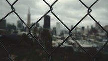 Looking through a fence at a city