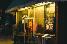 Used book store at night.