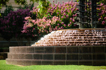 Tiered water fountain outdoors in a park.
