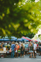 people gathered at a farmers market