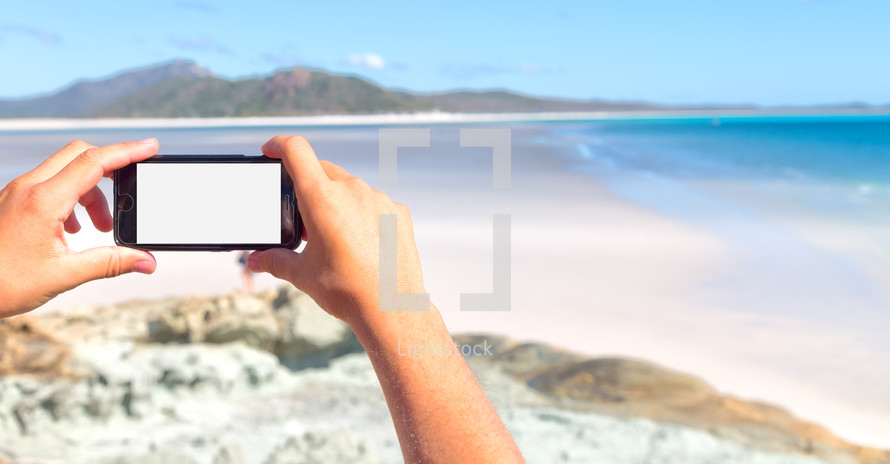 taking a picture of a beach with a cellphone